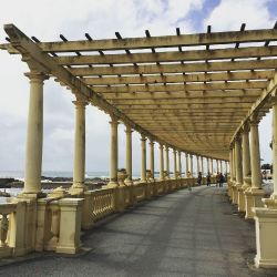 "If you're looking for the entire city of Porto come summer, head straight to the sea where fluttering umbrellas and tall glasses of Port and Tonic await you. While there, stroll under the ""Pergola da Foz"". Built in the 1930s, the pergola with balustrade was built per the request of the Mayor's wife at the time who craved a similar experience as the ""Promenade des Anglais"" pergola in Nice. #igers_porto #ig_porto #instaporto #Portugal #portugalcomefeitos #portugaldenorteasul #portugal_de_sonho #portugaloteuolhar #igersportugal #tourism #travel #catavino #tours #architectureCredit to Photographer: @andreiacardosobarbosa http://ift.tt/28Y6MSs"