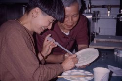 We're continuing the Studio at 20 celebration with a look back on some of our favorite memories. Shin-ichi and Kimiake Higuchi are pictured here experimenting with the techniques of pâte de verre, which uses a glass paste in a mold in order to create glass objects.