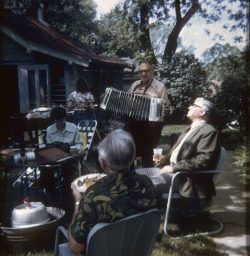 ed-piller-plays-concertina-at-a-backyard-party