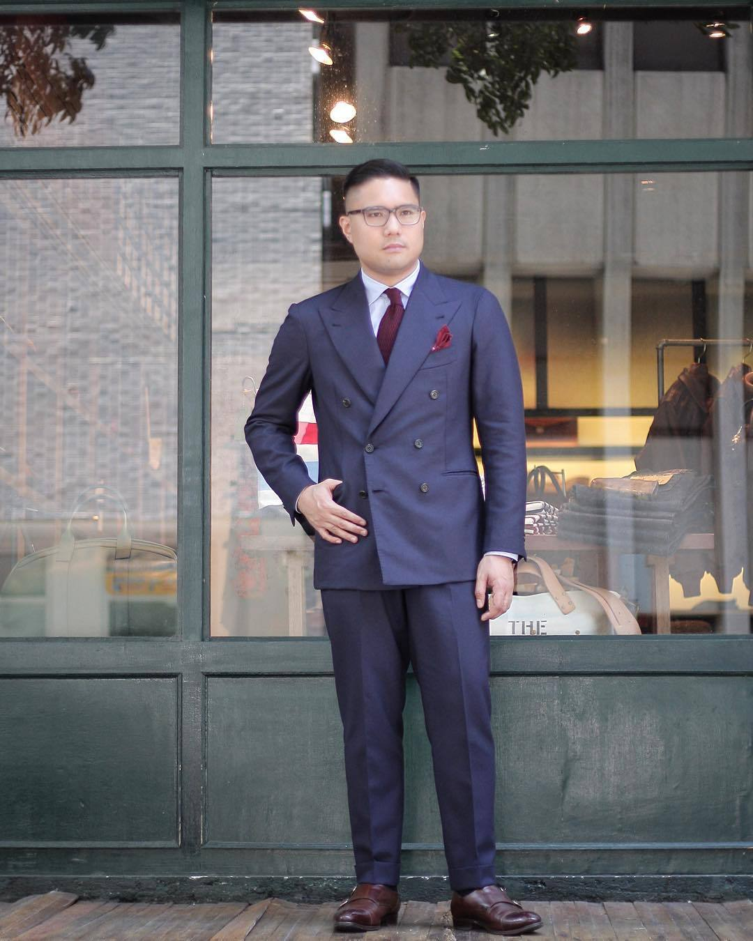 SIGNET — Navy double-breasted suit. Jacket by Orazio...