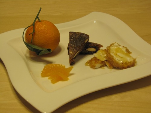 Almond and Honey coated Goat Cheese with Fig Cake and Satsuma Tangerine Supreme.