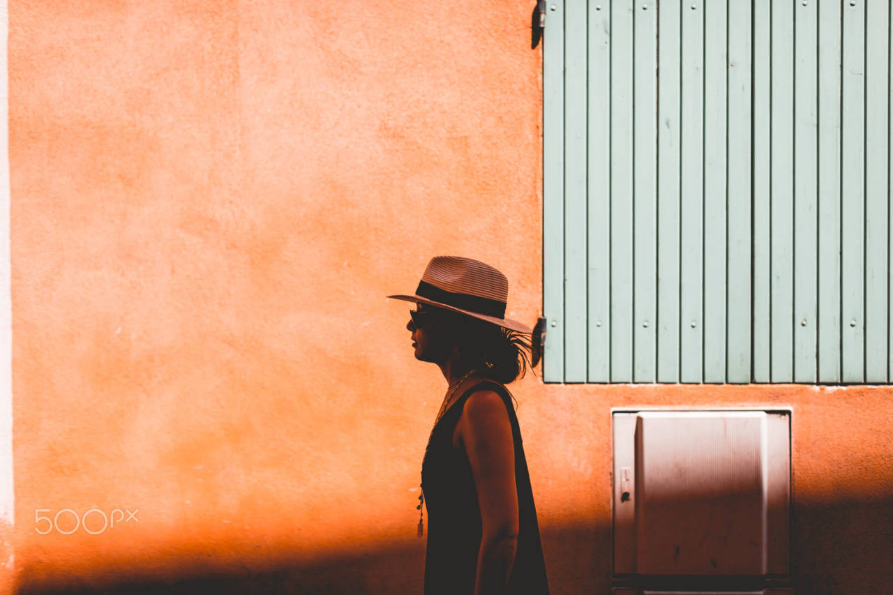 Alley Cat by Anthony Rayburn camera: Canon EOS 6D lens: Canon EF 50mm f/1.2L USM #500px#editors choice #one woman only #travel#travel destinations#freedom#exploration#wonderlust#independence#solitude#challenge#adventure#individuality #getting away from it all #strength#curiosity#france#orange#shadow#Sunlight#Day#Wall#Simplicity