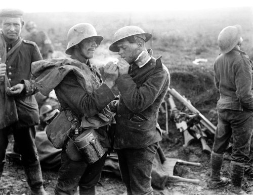 enemy soldiers share a cigarette during the wwi christmas truce december 24th 1914 - Wwi Christmas Truce