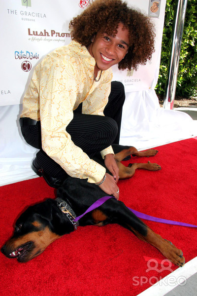 Corbin Bleu with a dog at a New Leash on Life charity event in Burbank, California #Corbin Bleu#actos#entertainers#dogs#puppies #black guys with puppies  #new leash on life