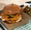 If you like butter chicken, you'd love this Butter Chicken Bombe @bindaseatery , a bitter chicken #burger on an organic brioche bun