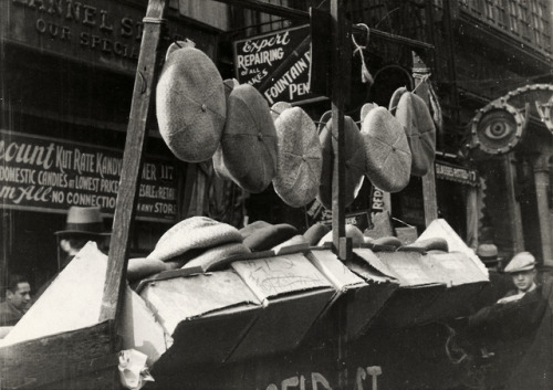 Flat caps displayed on a pushcart, Orchard Street, NYC, Photo by Browning Studio, 1928-30s