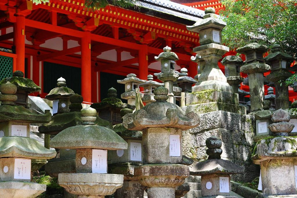 Stone lanterns by Teruhide Tomori on Flickr #Stone lanterns#old#travel#red#japan#garden#spring#shrine#traditional#structure#日本#nippon
