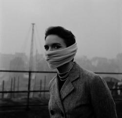 A lady with strings of pearls around her neck and a chiffon scarf around her nose and mouth during the Great Smog in London, , which ended up killing 12,000 people during its 5 days long stay