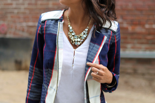 @pursuitofshoes Embellishes her outfit with a statement necklace and arm candy. See her look here.